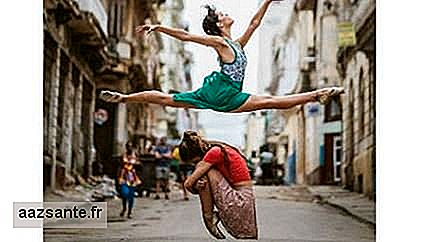 Photographer registers dancers dancing in the streets of Cuba