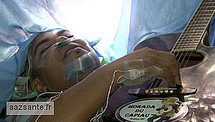 Musician sings and plays guitar during brain surgery