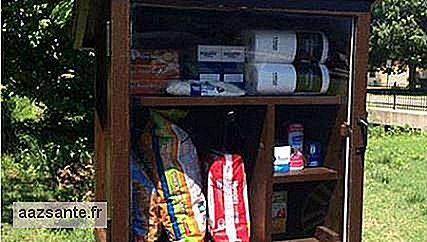 Young woman creates community pantry with food and toys